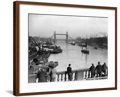 Pedestrians on London Bridge Watch Boats and Barges Being Unloaded--Framed Art Print