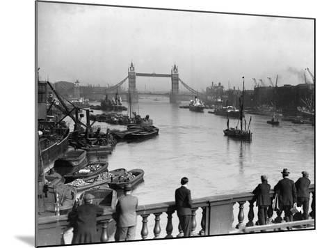 Pedestrians on London Bridge Watch Boats and Barges Being Unloaded--Mounted Photographic Print