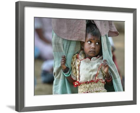 A Displaced Tamil Child Hangs to Her Father's Sarong-Gemunu Amarasinghe-Framed Art Print