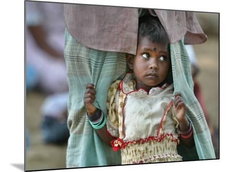 A Displaced Tamil Child Hangs to Her Father's Sarong-Gemunu Amarasinghe-Mounted Photographic Print