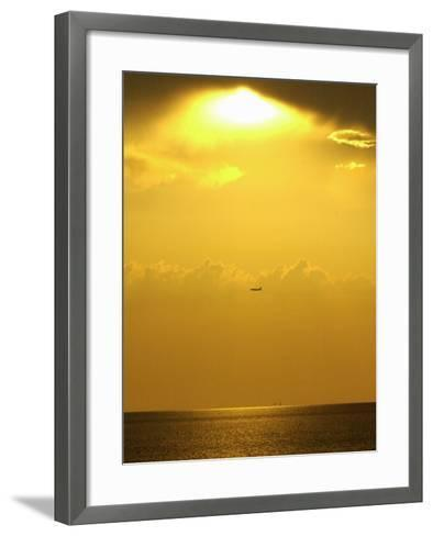 At Sunset a Commerical Jet Makes its Approach to Louis Armstrong New Orleans International Airport--Framed Art Print