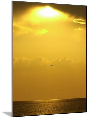 At Sunset a Commerical Jet Makes its Approach to Louis Armstrong New Orleans International Airport--Mounted Photographic Print