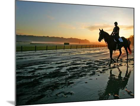 An Unidentified Horse and Rider on the Track at Sunrise at Belmont Park--Mounted Photographic Print