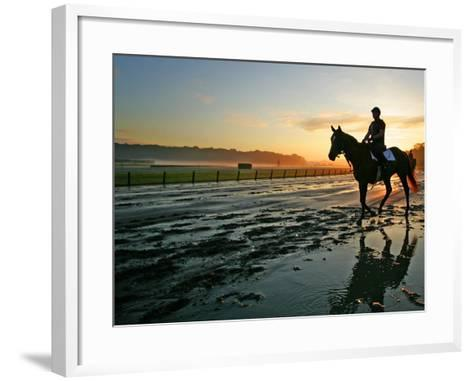An Unidentified Horse and Rider on the Track at Sunrise at Belmont Park--Framed Art Print