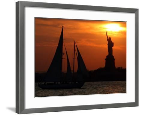 The Sun Sets Behind the Statue of Liberty on the Longest Day of the Year--Framed Art Print