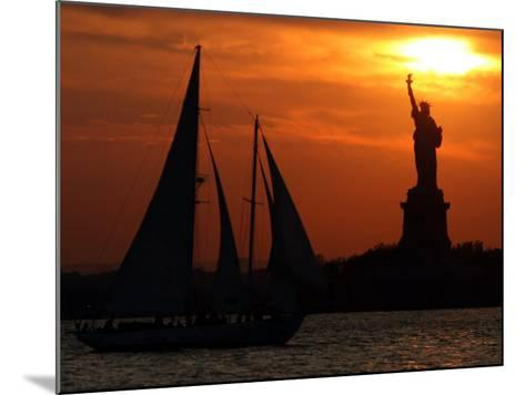 The Sun Sets Behind the Statue of Liberty on the Longest Day of the Year--Mounted Photographic Print