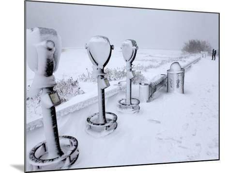 Telescope Viewers are Covered in Snow Overlooking Lighthouse Beach in Chatham, Massachusetts--Mounted Photographic Print