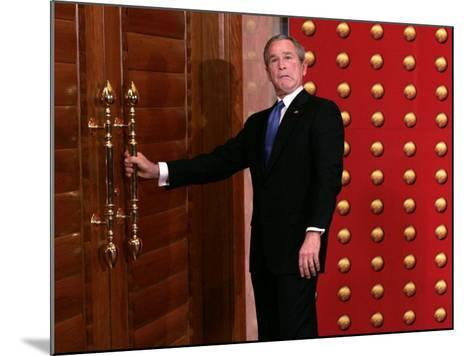 President George W. Bush as He Tries to Open a Locked Door Leaving a Press Conference in Beijing--Mounted Photographic Print