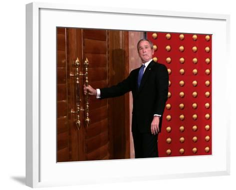 President George W. Bush as He Tries to Open a Locked Door Leaving a Press Conference in Beijing--Framed Art Print