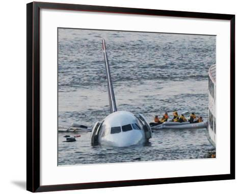 Passengers in a Raft Move from an Airbus 320 US Aircraft That Has Gone Down in the Hudson River--Framed Art Print