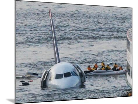 Passengers in a Raft Move from an Airbus 320 US Aircraft That Has Gone Down in the Hudson River--Mounted Photographic Print