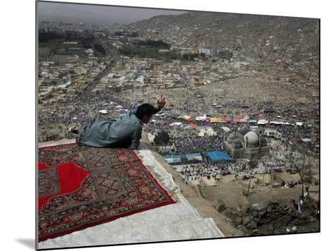 Afghan Youth Sits on a Rooftop During the Celebration of Nowruz--Mounted Photographic Print