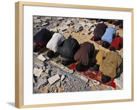 Palestinians Pray in Rubble of Mosque Destroyed in Israeli Military Offensive, Northern Gaza Strip--Framed Art Print