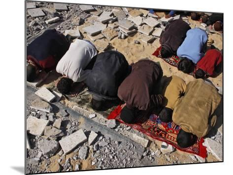 Palestinians Pray in Rubble of Mosque Destroyed in Israeli Military Offensive, Northern Gaza Strip--Mounted Photographic Print
