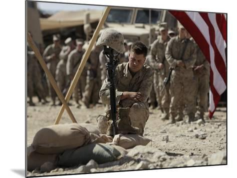 US Marine Pays His Respects to LCpl Joshua Bernard During a Memorial Service at Base in Afghanistan--Mounted Photographic Print