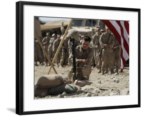 US Marine Pays His Respects to LCpl Joshua Bernard During a Memorial Service at Base in Afghanistan--Framed Art Print