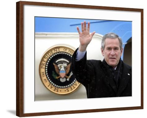 U.S. President George W. Bush Waves as He Steps out of the Air Force One--Framed Art Print