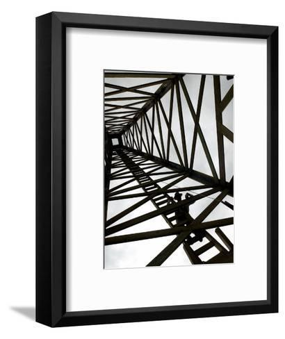 A Reenactor is Silhouetted Inside a Replica of the Spindletop Oil Derrick--Framed Art Print
