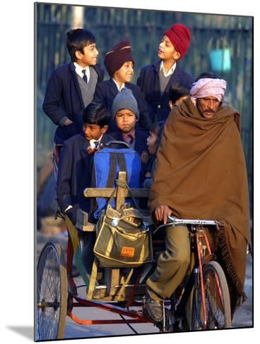 Indian Children Ride to School on the Back of a Cycle Rickshaw--Mounted Photographic Print