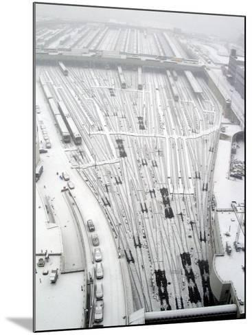 Snow Covers the Railroad Tracks at the Westside Railyard as Snow Falls on New York--Mounted Photographic Print