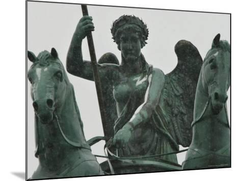 First Snow Sits on the Quadriga on Top of Berlin's Brandenburg Gate--Mounted Photographic Print
