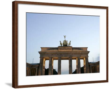 The Brandenburg Gate Glows in the Evening Light in Berlin--Framed Art Print