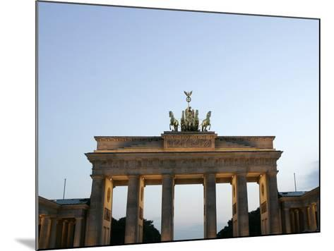 The Brandenburg Gate Glows in the Evening Light in Berlin--Mounted Photographic Print