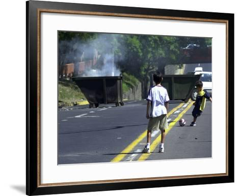 Two Children Take Advantage of a Blockade--Framed Art Print