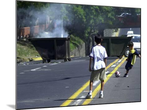Two Children Take Advantage of a Blockade--Mounted Photographic Print
