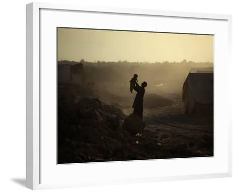 Displaced Man Holds His Baby Next to His Tent in Jalozai Refugee Camp Near Peshawar, Pakistan--Framed Art Print