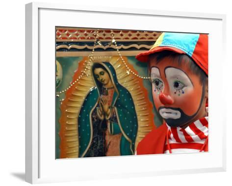 """Young Clown, """"Bolillito,"""" Stands Next to an Image of the Virgin of Guadalupe in Mexico City--Framed Art Print"""