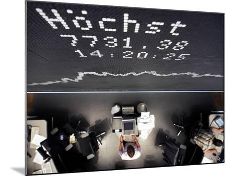 Brokers Under a Curve of German Stock Index Dax at Stock Market in Frankfurt, Central Germany--Mounted Photographic Print