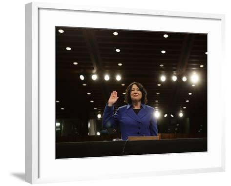 Supreme Court Nominee Sonia Sotomayor is Sworn in on Capitol Hill in Washington--Framed Art Print
