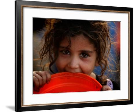 Afghan Refugee Child Who Lives in Slum Area of Lahore City in Pakistan Waits to Get Water--Framed Art Print