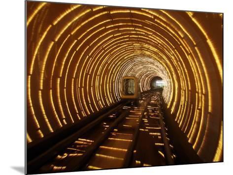 Empty Tourist Subway Car Runs Through Illuminated Tunnel in Shanghai, China--Mounted Photographic Print