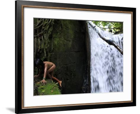Child from the Ache Indigenous Group Plays Near a Waterfall in Cerro Moroti, Paraguay--Framed Art Print
