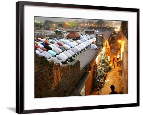 Indian Muslims During Friday Evening Prayers on the Rooftop of a Building over an Auto Parts Market--Framed Art Print