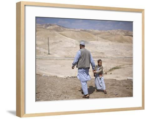Palestinian Father and Son Walk in Desert During Celebrations Marking the Annual Day of Nebi Musa--Framed Art Print