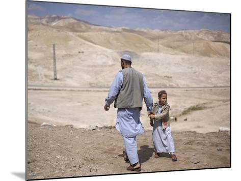 Palestinian Father and Son Walk in Desert During Celebrations Marking the Annual Day of Nebi Musa--Mounted Photographic Print