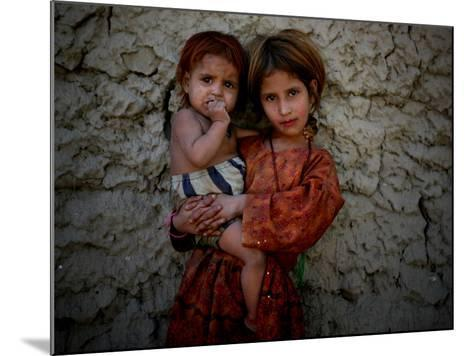 Afghan Girl Holds Her Younger Sister in Nangarhar Province, East of Kabul, Afghanistan--Mounted Photographic Print
