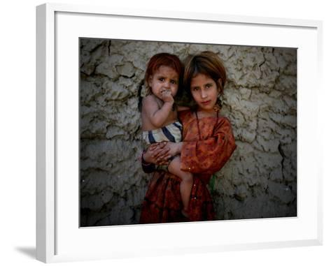 Afghan Girl Holds Her Younger Sister in Nangarhar Province, East of Kabul, Afghanistan--Framed Art Print