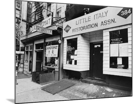 A Chinese Laundromat is Seen Next Door to the Offices of the Little Italy Restoration Association--Mounted Photographic Print