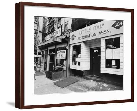 A Chinese Laundromat is Seen Next Door to the Offices of the Little Italy Restoration Association--Framed Art Print