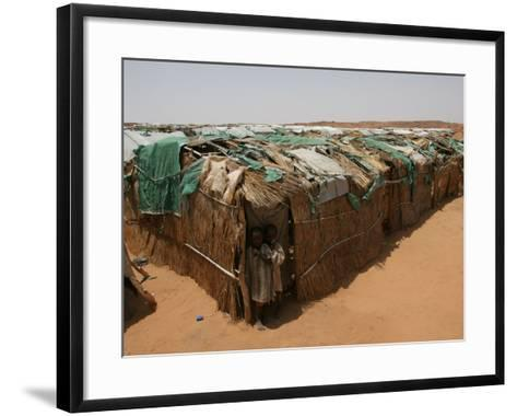 Two Sudanese Boys Stand by Makeshift Huts--Framed Art Print