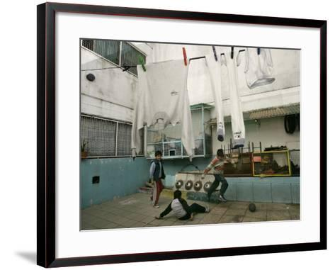 Children of an Immigrant Family from Bolivia Play Soccer at Their House--Framed Art Print