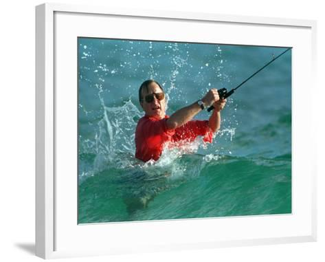 Waves Splash President-Elect George Bush as He Casts a Line While Surf-Fishing--Framed Art Print
