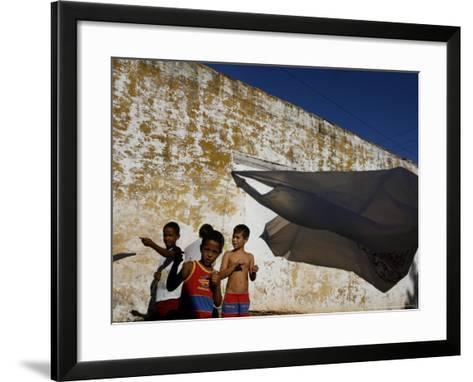 A Group of Children Fly Plastic Bags, Known as Papalotes-Javier Galeano-Framed Art Print