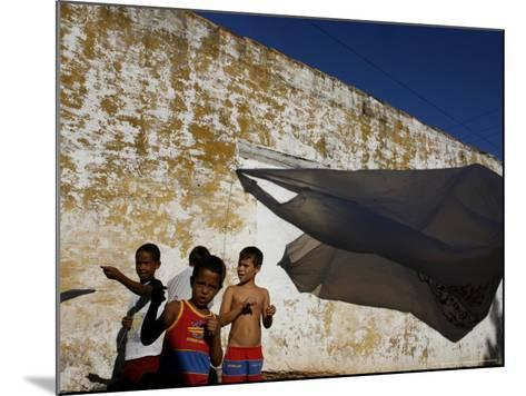 A Group of Children Fly Plastic Bags, Known as Papalotes-Javier Galeano-Mounted Photographic Print