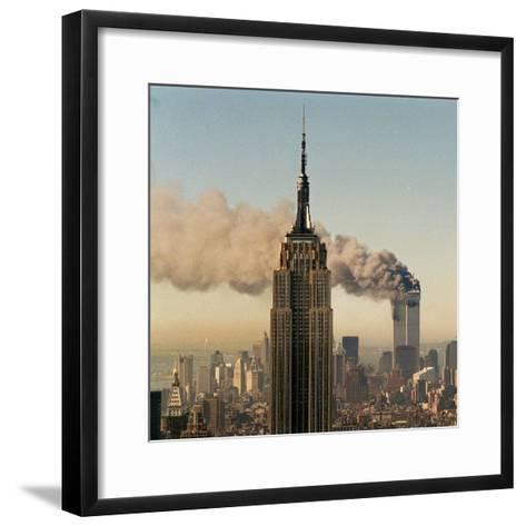 Twin Towers of the World Trade Center Burn Behind the Empire State Buildiing, September 11, 2001--Framed Art Print