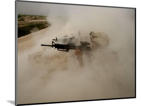 US Marines Return Fire on Taliban Positions Near the Town of Garmser in Afghanistan--Mounted Photographic Print